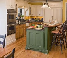 two tone kitchen cabinets. Interesting and different