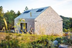 Compact Karst House offers a contemporary twist on classic countryside living in Slovenia