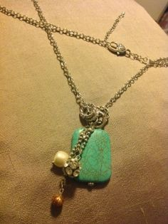 Large teal with accent beads in silver.  By Renewed Root.