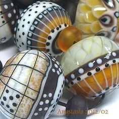 Anastasia Beads...love how the black and white dots bring these earthy colors to life.
