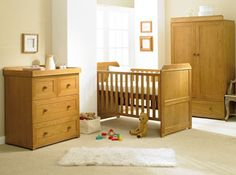 A classic collection from East Coast, the Langham nursery furniture is made from solid oak wood and includes a cot bed, dresser and wardrobe. Nursery Furniture, Kids Furniture, Sleigh Cot Bed, Baby Shop Online, Hanging Rail, Babies R Us, Kid Beds, Room Set
