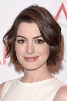 She's one of Hollywood's most gorgeous actresses, but Anne Hathaway hasn't always been so glam. See the Les Miserable star's transformation from girl-next-door to red carpet royalty.