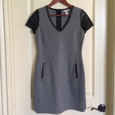 Banana Republic Dress Grey dress with faux leather trim and sleeves.  Back exposed zipper detail.  Stunning dress.  Never worn, NWOT Banana Republic Dresses