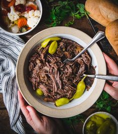 Juicy, tender and flavorful slow cooker Italian Beef is an easy dinner recipe that's perfect for busy days. Serve the shredded meat and pepperoncini on a hoagie roll with giardiniera and melted Provolone cheese for a classic Chicago Italian Beef Sandwich, or pair the roast beef with mashed potatoes, noodles, or rice for a cozy comfort food supper. You can't beat the convenience of an all-day slow cooker meal! Everyone loves the ease and versatility of succulent, shredded Italian roast beef that