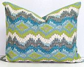I adore these pillows from Etsy! Having a few pieces that contain all of the colors in your scheme is great! (and this is an awesome price)