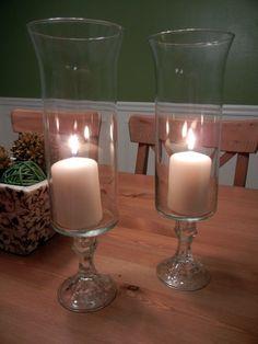 Two dollar hurricanes! Dollar Tree vases hot glued to Dollar Tree candlesticks.