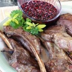 """Grilled Lamb Chops with Pomegranate-Port Reduction I """"Absolutely amazing! My guests wanted to lick the plate. The sweetness of the pomegranate-port reduction was a nice balance against the lemon marinated lamb chops."""""""