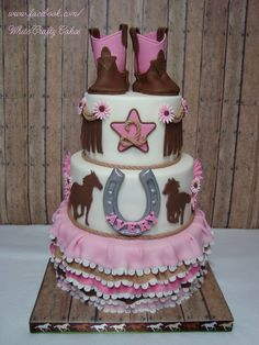 Little Cowgirl Cake - A sweet little girly western themed cake for adorable Avery's 2nd birthday. I had so much fun making her cowgirl cake!  All the details are fondant.  Loved making the little cowgirl boots!  Thank you so much for looking!