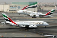 """Peak afternoon departure time. A6-EDJ carrying the """"Rugby World Cup England 2015"""" titles. - Photo taken at Dubai - International (DXB / OMDB) in United Arab Emirates in June, 2015."""