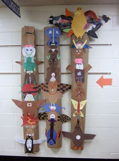 """5/6 Year Intro Identity Totem Poles.  Students read about meanings of animals in Native American research then chose one that they felt represented them and personalized it. These three """"poles"""" represent one class."""