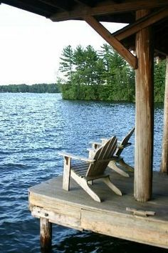 Waterside seats on the dock in the woods