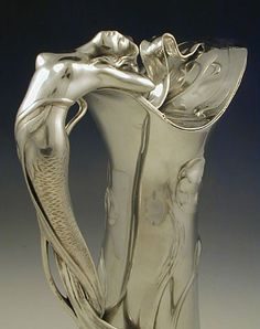 Polished pewter flagon with a handle in the form of a figural art nouveau mermaid; Germany, c.1906