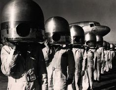 """TWA mechanics at La Guardia Field resemble men from space after donning metal propeller hubs. 1941"""