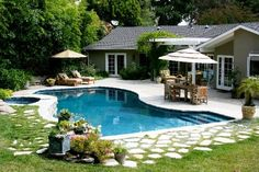... of Shesez's California backyard with a pool and outdoor living room