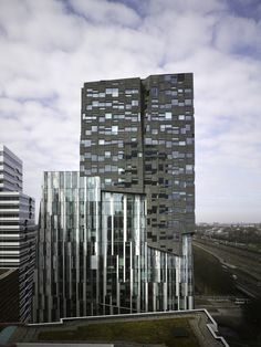 """Erick van Egeraat office tower (also called """"The Rock"""") in Amsterdam, The Netherlands - photo by Christian Richters, via archdaily;  designed by Erick van Egeraat architects;  This is a high-density mixture of offices, housing, retail, and public space that looks different from each angle. It is part of an urban high-rise development in Amsterdam called Zuidas."""