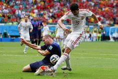 Credit: MARCOS BRINDICCI/REUTERS Ron Vlaar blocks an early shot from Costa