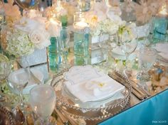 Love this table -- silver beaded chargers, mirror accents
