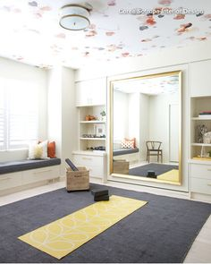 Murphy bed hidden behind mirror. Love the idea of wallpaper on the ceiling too.