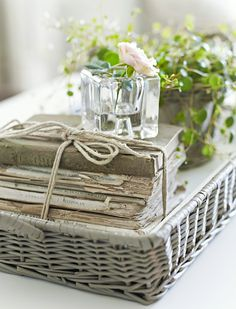 weathered wicker, old books, fresh flowers and greenery