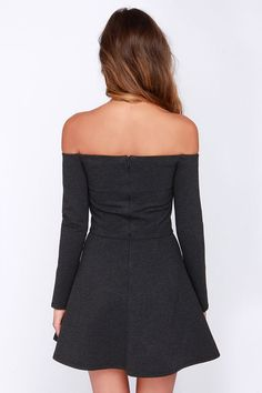 Even when it's cold outside, you can still unleash your inner vixen in the Cold Spells Charcoal Grey Off-the-Shoulder Dress! This enchanting long sleeve dress has a thick stretch knit to keep you warm, while showing off a little shoulder. Fitted bodice transitions into a full, box-pleated skirt with vertical front pockets. Hidden back zipper/hook clasp.Unlined. 60% Rayon, 35% Polyamide, 5% Spandex. Hand Wash Cold.