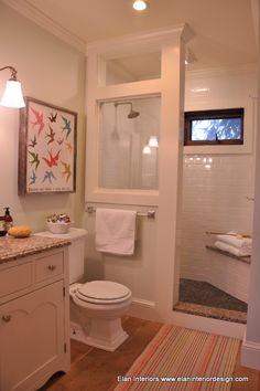 I like the moldings and the glass in this bathroom. Perfect for an old house. Elan Interior Design Residential Design - Elan Interior Design