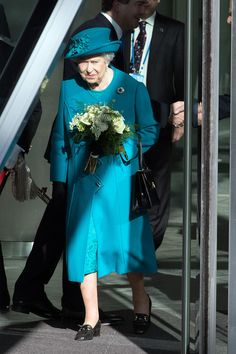 Queen Elizabeth II Photos Photos - Britain's Queen Elizabeth II leaves after officially opening the National Cyber Security Centre on February 14, 2017 in London, England. The National Cyber Security Centre (NCSC) is designed to improve Britain's fight against cyber attacks and act as an operational nerve centre. - The Queen & Duke Of Edinburgh Open The National Cyber Security Centre
