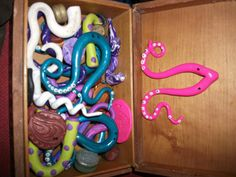our box full of goodies, note the cute little pink squid :3