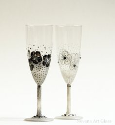 Set of 2 Hand painted wedding toasting champagne flutes in black (dark grey metalic) and white, lace effect. gentle floral pattern. Decorated with Curt Glass Crystals.   Claсsиc black and white design, great for black & white wedding.    Height 22cm  15cl / 5 oz  Gift pack and ready to ship!    To Personalized these glasses:  I can paint your names on the base of the glasses.  When you purchase, please leave names and date in message/note to the seller      Only hand washing. Do...