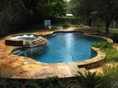Just a simple little pool with gorgeous stone work and a runoff hot tub to keep the pool semi-toasty! Perfect!