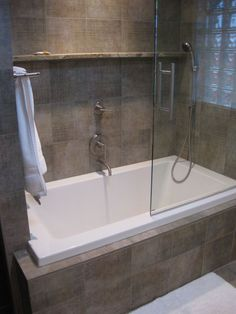 Jetted tub inside shower stall for tight spaces