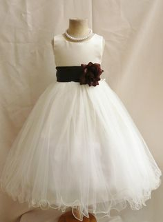 Love this flower girl dress, I could have one in the black ribbon and the other in an orange ribbon.