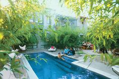 Hip Hangout: Hotel San José - Cool Pools, Great Stays - Southernliving. Bigger isn't always better--at least not in the case of swimming pools.    The one at Hotel San José in Austin measures 8 x 24 feet and never exceeds more than 5 feet deep.  That's a modest size, smaller than most backyard pools and only a fraction larger than the ones you blow up. Still, this pool rates as one of the coolest places to be in all of the Lone Star State. Surrounded by tall stalks of bamboo and…