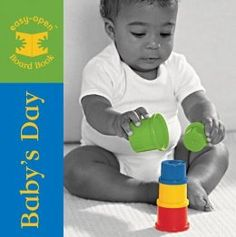 """Baby's Day: Michel Blake - $4 - 2008 Oppenheimer Best Book Award - photos of an adorable African American baby playing with familiar toys are printed in black and white with the item featured printed in primary colors.  Each of the """"knowing and naming"""" items are on their own separate page.  Pages are graduated, not cut to the same size, making them easy to turn.  6 months and up."""