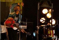"""Chris Martin from Coldplay performs in an Earth Hour t-shirt in 2009. The band's song """"Fix You"""" was used as part of the Vote Earth campaign in 2009, and as the official song for the Earth Hour 2010 video."""