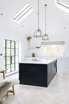 Minimal modern farmhouse kitchen with Shaker cabinets, high ceilings and modern . Minimal modern farmhouse kitchen with Shaker cabinets, high ceilings and modern lighting - found on Hello Lovely Studio Kitchen Flooring, Shaker Style Kitchens, Devol Kitchens, Kitchen Remodel, Modern Kitchen, Home Kitchens, Modern Farmhouse Kitchens, Kitchen Living, Kitchen Design