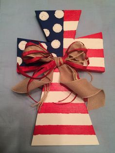 Hand painted American flag wooden cross.  #crosses #flag #american Painted Wooden Crosses, Hand Painted, Cheap Christmas Presents, Flag Painting, Wooden Crafts, Red White Blue, Bible Quotes, Pallets, American Flag