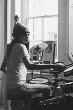 ((Open RP)) I sit in my apartment, my music blasting as I drum along to it. I don't notice you standing there, watching
