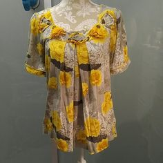 Anthropologie Yellow Blouse Top L Large Ric Rac Size L blouse originally from Anthropologie.  Yellow and grey color.  Worn and line dried only.  In great shape.  This is a generous large and could fit bigger than a 14. It is a knit material. Anthropologie Tops Tees - Short Sleeve
