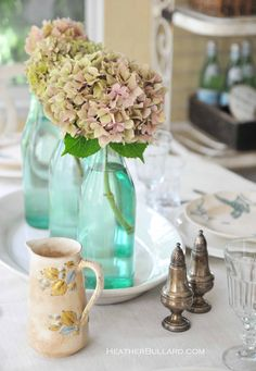 Keep your wedding eco-friendly with recycled vases for a centerpiece