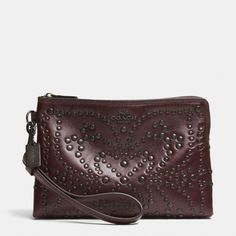 The Mini Studs Large Wristlet In Leather from Coach. Please and thank you.
