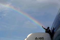 May the Force be with you - Obama shoots rainbow with his hand - White House photographer Pete Souza, in Jamaica 2015