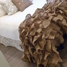 Love the bedspread and the bed skirt.. Not too big on the burlap on the bed