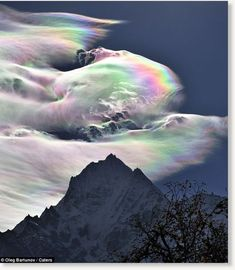 Wow.  Gorgeous reflections over Mount Everest.