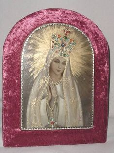 Antique Blessed Virgin Mary painted on silver with gemstones and velvet backing.