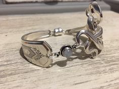 A personal favorite from my Etsy shop https://www.etsy.com/listing/494606261/1932-fork-bracelet