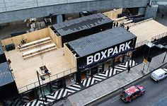 London's first Pop-Up Shipping Container Mall Opens in Shoreditch. Boxpark Shoreditch is London's first pop-up shopping mall made completely from shipping containers. Container Architecture, Container Buildings, Container Cafe, Cargo Container, Container Garden, Contemporary Architecture, Architecture Design, Landscape Architecture, Retail Architecture