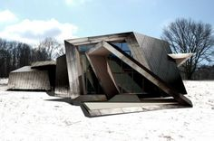"""This Connecticut residence is formed by a spiraling ribbon of 18 planes, defined by 36 points connected by 54 lines"". Studio Daniel Libeskind"