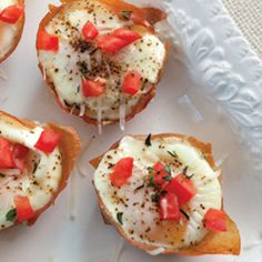 brunch food! eggs baked on bread in the oven garnished with black pepper, parm cheese, and tomato