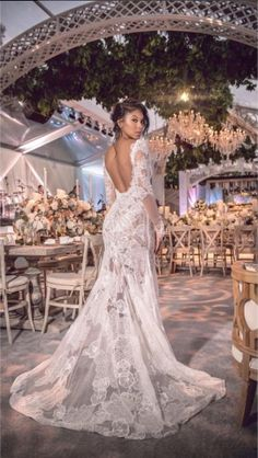 ddbace1b6 Eniko Parrish wore a custom Vera Wang French Chantilly lace wedding gown  with long sleeves to