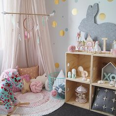 Such a sweet baby nursery with corner canopy and gold polka dot confetti wall. Instagram photo by miss.lily.loves